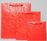 최신 각인하거나 높은 광택 있는 완료를 가진 인쇄된 물색 서류상 선물 부대