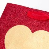 バレンタインデーの重いきらめきの大きい中心のギフトの紙袋の買物袋印刷された袋