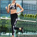 Износ гимнастики спорта обжатия нажимает вверх бюстгальтер спорта