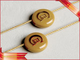 Étiquette s'arrêtante de joint de dispositif de fixation en plastique de chaîne de caractères de vêtement