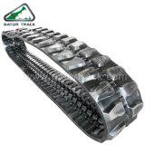 A borracha segue as trilhas da máquina escavadora (450X83.5K)