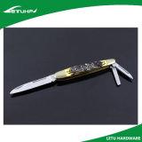 El plegable cerco el cuchillo con las láminas duales de la punta de la gota