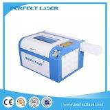 Konkurrenzfähiger Preis-Tuch/Schuhe/Leder/Gewebe-Laser-Stich u. Ausschnitt-Maschine