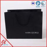 Le bleu stratifié stigmatise les sacs en papier promotionnels de transporteur pour faire des emplettes avec le logo