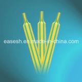 Grüne gelbe Rohrleitung des Wärmeshrink-2X