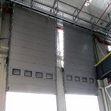 Industrieel Elektrisch Verticaal Bovenleer dat Sectionele Deur glijdt