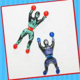 Het plastic Stuk speelgoed van de Spin van de Gang van de Muur met Suikergoed