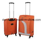 Bolso anaranjado del equipaje de la carretilla del color