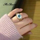Lo stile punk squilla gli anelli di cerimonia nuziale blu dell'occhio diabolico della resina di colore