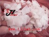 La soda cáustica elevada de la pureza (hidróxido de sodio) forma escamas el 99%