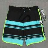 La spiaggia dello Swimwear di marca di Shorts degli uomini mette gli Shorts in cortocircuito della scheda di spuma degli uomini
