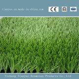 Alfombra sintetizada verde de la hierba