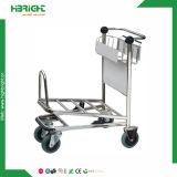 Carros de la carretilla del equipaje del aeropuerto con la rotura auto de la mano