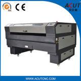 Máquina nova do laser do CNC usada na gravura de madeira e na estaca