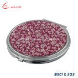 Specchi rossi di trucco del bello fiore sulla vendita