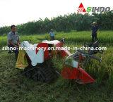 Manuellement déchargement du petit prix usine bon marché de moissonneuse de riz en vente
