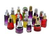 Botella de cristal líquida vacía cosmética del cuentagotas del petróleo esencial