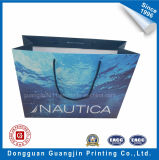 Sacchetto di acquisto di carta stampato dell'acqua blu di alta qualità per l'imballaggio dell'indumento