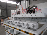 Una Tabella delle 4 Multi-Teste di asse che si muove con il router rotativo di CNC di asse