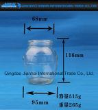Vaso ovale della bottiglia di vetro con il marchio dell'incisione