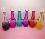 Цветастая стеклянная бутылка брызга дух