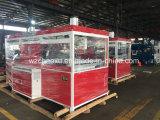 Vuoto di caso di bellezza della valigia che forma macchina nella linea di produzione