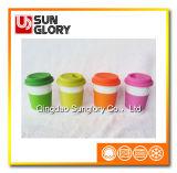 Reforçar a caneca da porcelana com caixa do silicone e a tampa de Lkb016