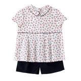 Les enfants mignons en gros vêtant l'été de filles vêtx le T-shirts de coton