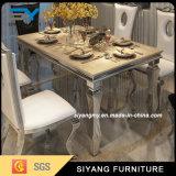 Tabella pranzante di marmo della mobilia dell'acciaio inossidabile con 6 genti