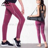 Ghette atletiche di forma fisica degli abiti sportivi dei pantaloni delle donne che eseguono i vestiti di yoga dei vestiti