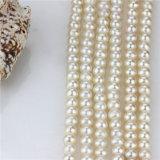 Lose Frischwasserperle schwemmt en gros 7mm nahe runde die echte Perle-Zeichenkette an