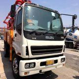 Pompe à béton Putzmeister montée sur camion Isuzu d'occasion avec système à distance / manuel