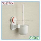 Escova e suporte fixados na parede de limpeza do toalete com copo da sução