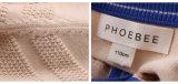 100%년 소년을%s 면에 의하여 뜨개질을 하는 봄 또는 가을 아이 착용