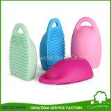 La despedregadora cosmética del cepillo del huevo del cepillo de los huevos de la limpieza del silicón compone el producto de limpieza de discos de cepillo