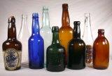 botella de cerveza de cristal ambarina 330ml con el casquillo hermético de la tapa del oscilación