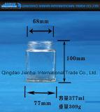 Botella de cristal del almacenaje de la cocina con el casquillo de la prueba del escape