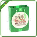 Sacs de fantaisie de cadeau de papier de Noël avec des traitements