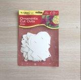 Salidas del corte de los ornamentos de la decoración de la Navidad para el papel blanco de la tarjeta