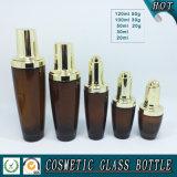 Bernsteinfarbige Kosmetik Glasflasche und Glas-Sahneglas mit glänzender Goldkappe