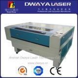 Machines de gravure acryliques en bois en cuir de découpage de laser de forces de défense principale de tissu