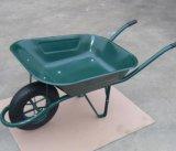 O edifício utiliza ferramentas o carrinho de mão de roda para o jardim