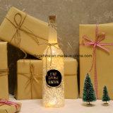 LEDのコルクおよび星明かりのストリングライトこつのリングが付いているガラスワイン・ボトルが付いている装飾的なびんライト