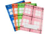 印刷されたカバーが付いている中とじの演習帳