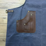 O costume encerou o avental do trabalho da lona com guarnição de couro