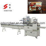 Sucrerie automatique alimentant et machine à emballer