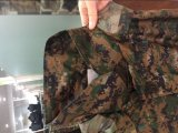 As forças armadas camuflam Raincoats