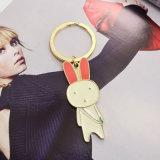Rosafarbenes weißes Decklack-reizendes Kaninchen-Schlüsselring im Überzug-Gold