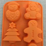 Noël mignon modelant le moulage de gâteau de silicones
