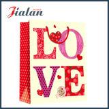 Les ventes en gros façonnent conçoivent le sac de papier estampé par logo de jour du `S de Valentine